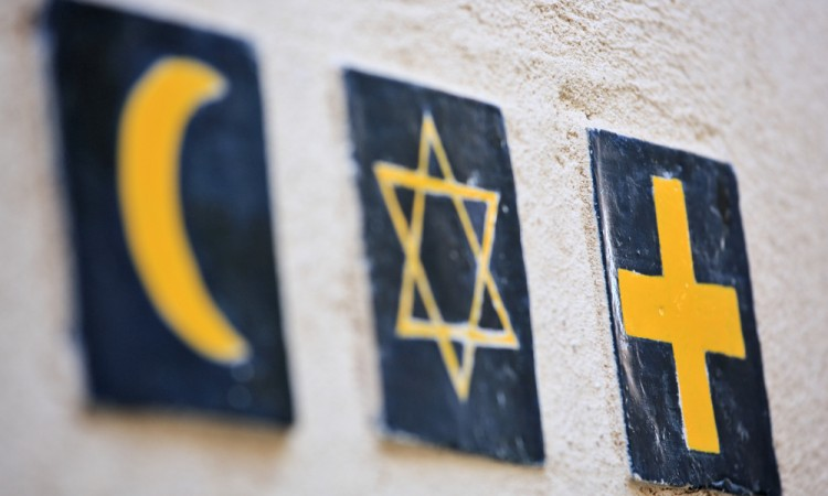 The risk factor in religious marks: a study of four major jurisdictions
