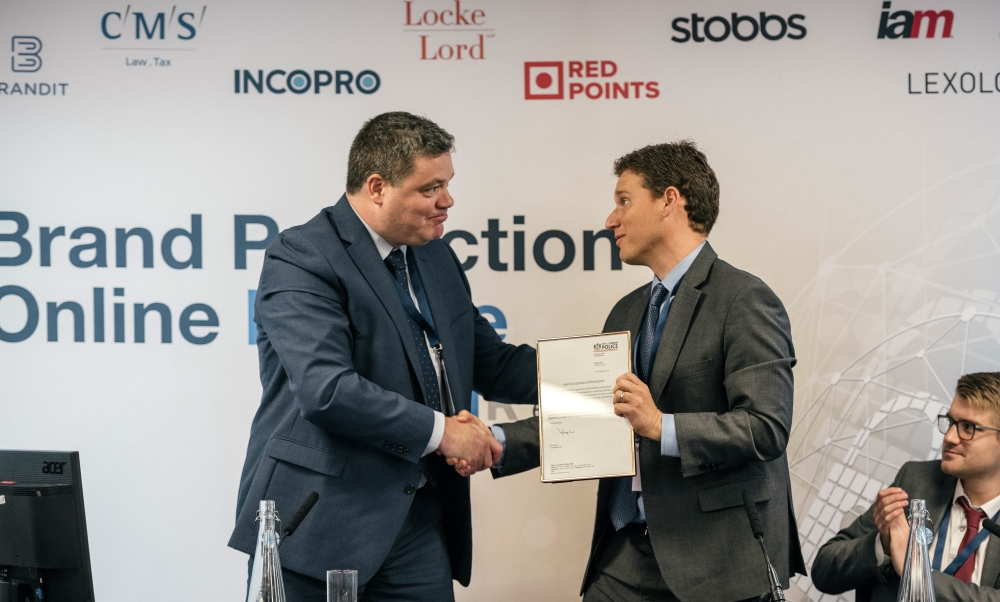 Alibaba's Matthew Bassiur receiving a commendation from PIPCU's Peter Ratcliffe